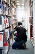 Student selecting books to read