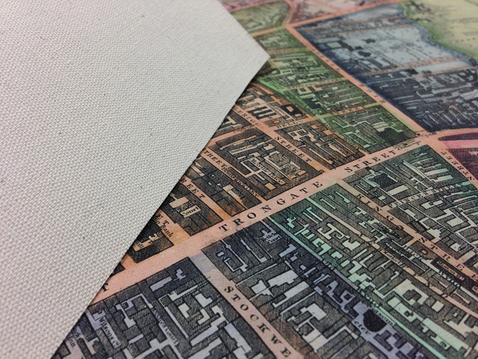 An example of the front and back of a map printed onto canvas. Please pop into the department to see a sample.