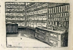 "Early book shop with books on shelves and boxes for books 'in sheets' from Comenius' ""Orbis sensualium pictus"" (Sp Coll S.M. 360)"