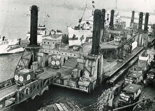 In service: Spud pierhead showing hospital ship and L.C.Ts