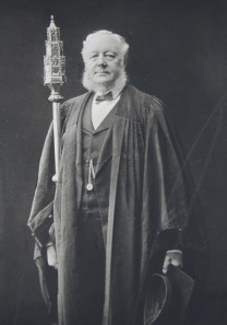 Lauchlan Macpherson, Bedellus from 1862 to 1899, carrying the Mace. Photograph from The University of Glasgow – Old and New, 1450 – 1891, ed. by William Stewart (Glasgow: T. & R. Annan & Sons and James Maclehose & Sons, 1891)