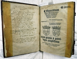 Titlepage of Manderston's Bipartitum, with early manuscript verse on facing page (Sp Coll BE6-b.11)