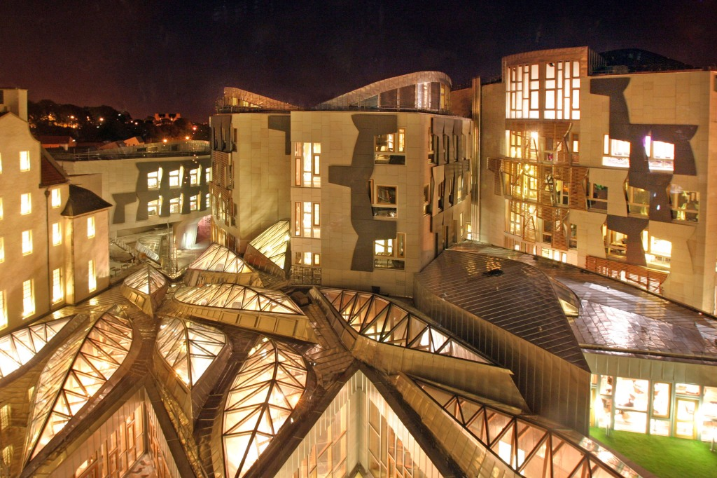 Scottish Parliament lit at night
