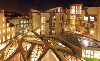 Scottish Parliament lit at night