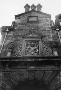 The royal arms of Charles II, added to the High Street frontage after the Restoration of the monarchy in May 1660.
