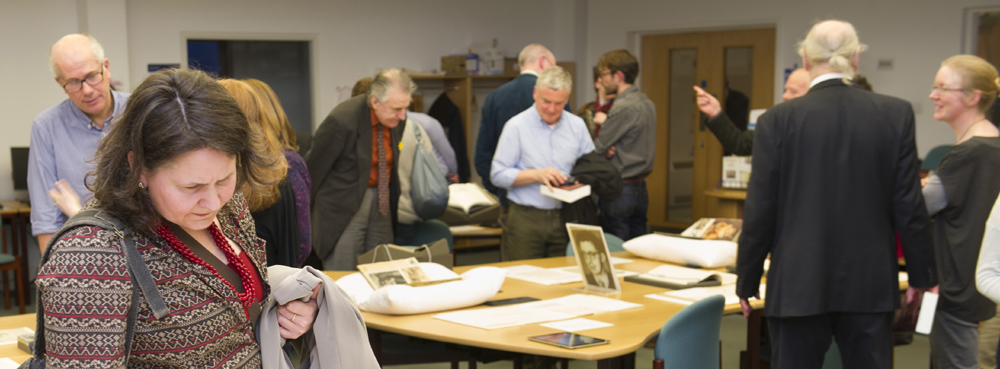 Guests in conversation and viewing material from the Edwin Morgan Papers.