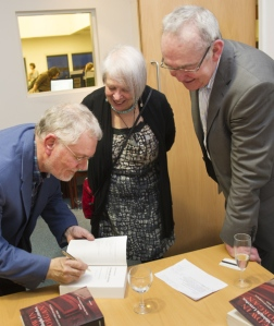 Liz Lochhead, Scotland's National Poet, has her copy of the 'Midnight Letterbox' signed by the editors.