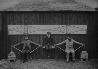 Watanabe (centre) demonstrating the cantilever bridge principle with Sir John Fowler and Sir Benjamin Baker