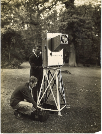 Photograph of G.B. Banks, who designed the apparatus, and Baird, operating a 'Noctovisor', a device using infra-red rays to transmit the image of a subject not visible to the eye, 1929. (Ref: MS Gen 1601/1)