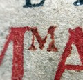 Detail of hand-stamped M (Sp Coll Mu31-e.11)