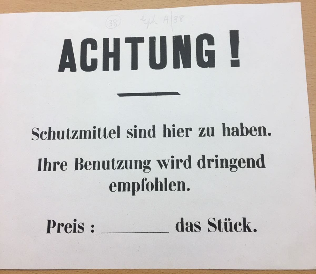 """A public note, written in German, about buying """"protection"""" (i.e. condoms), the use of which is recommended. Between 1915-18 Collection Reference: Eph.A/38"""
